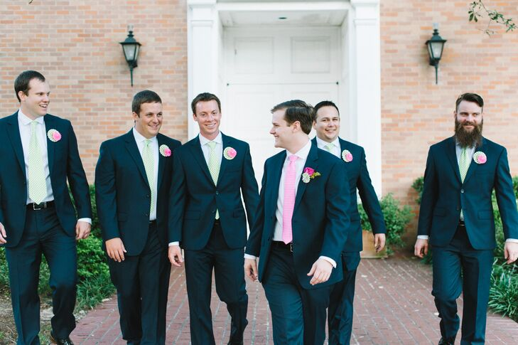 grooms navy suit and pink tie