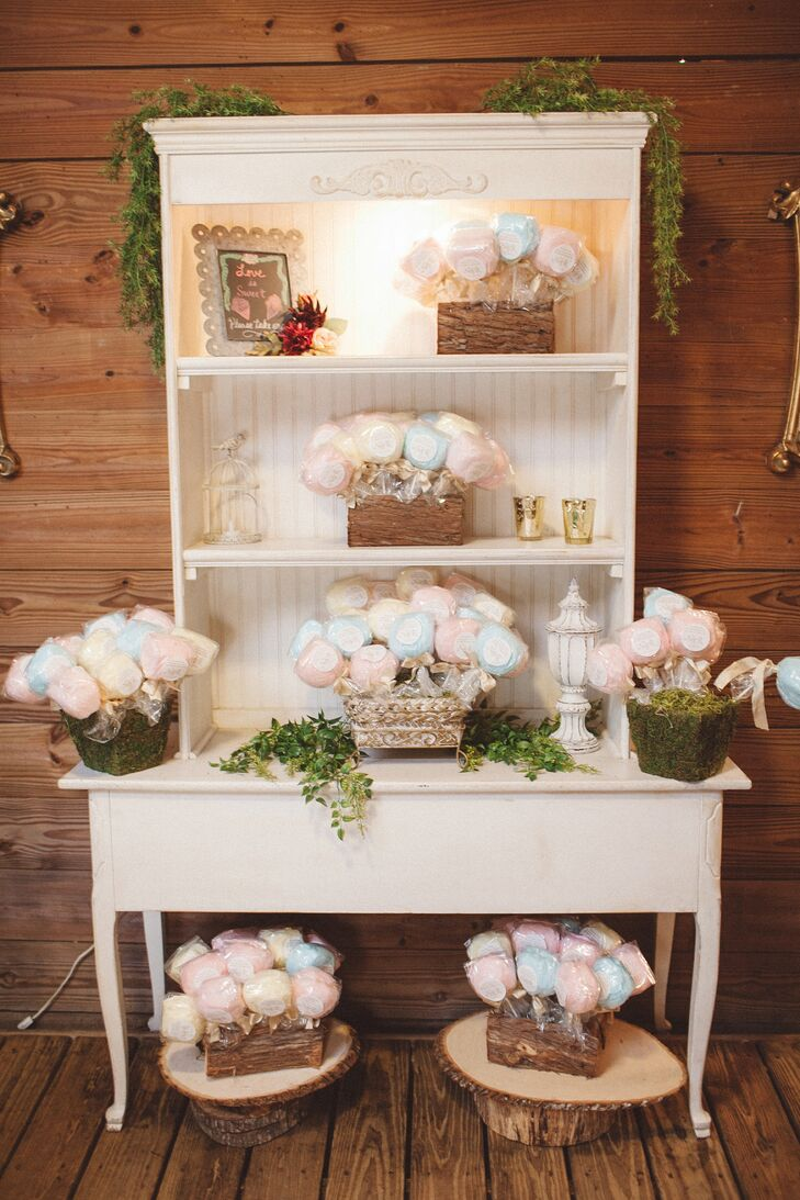 "The guests were given whimsical cotton candy lollipops as their wedding favors. A label with ""Thanks for making our day so much sweeter,"" was placed on each blue raspberry, pina colada or pink vanilla flavored confection. ""I wanted a fun foodie gift that showed our playful side. They were displayed at the front of the barn,"" says Nikole. For their guests preferred a different treat, the couple also had a gourmet coffee and hot chocolate bar in the barn's stable rooms."