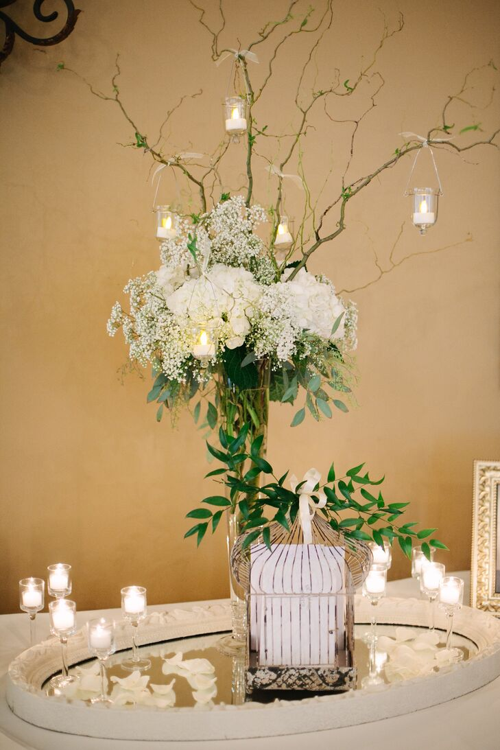 Tall white flower and branch centerpiece with hanging candles