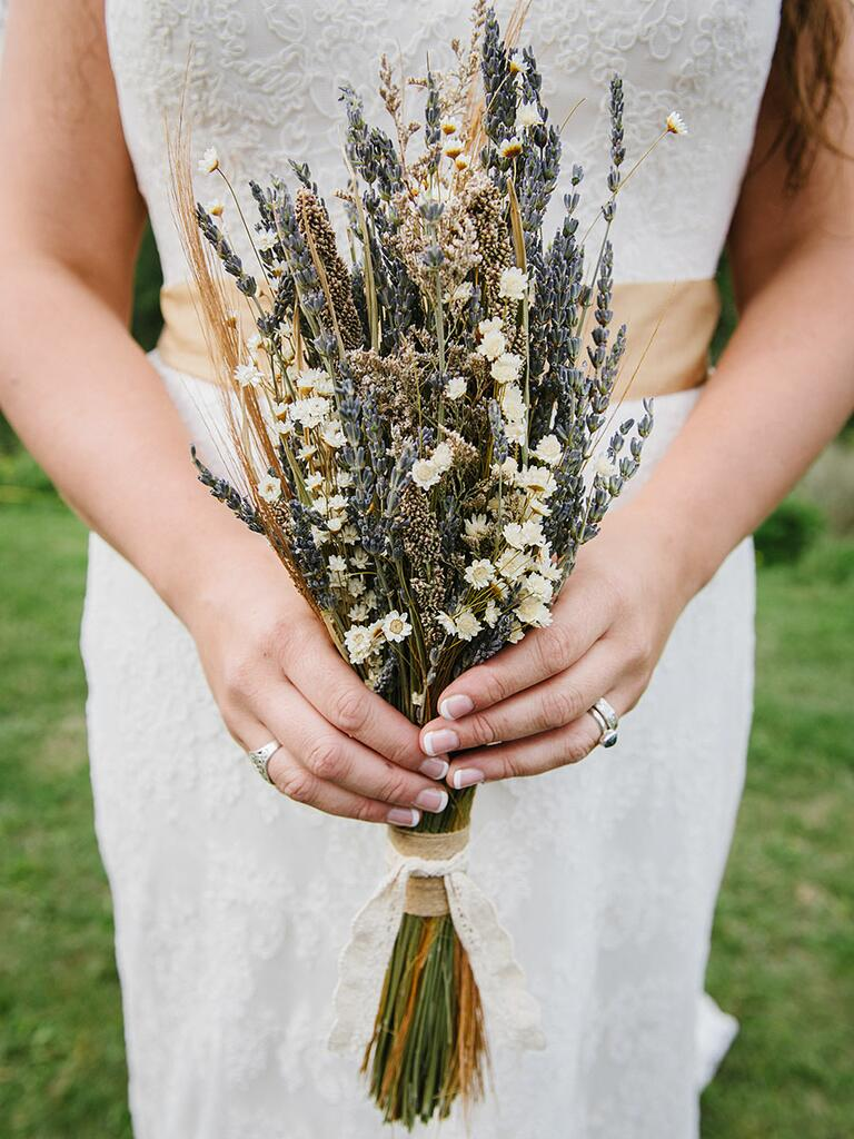 Rustic wedding bouquet with dried lavender, daisies and grasses