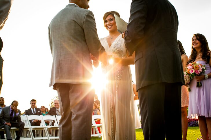 The happy couple held hands during their wedding ceremony at Herrington on the Bay.