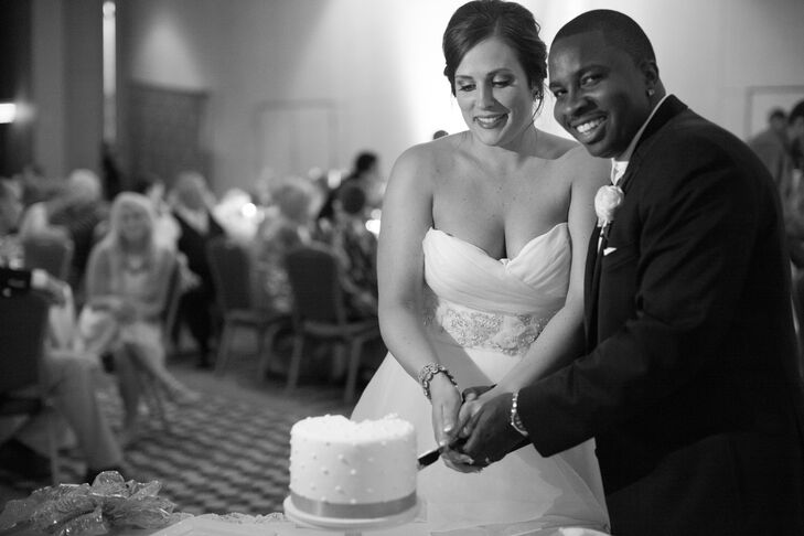 Since Ali and Willie had a dessert buffet, they kept their cake simple. Buttercream bakery created a one-tier Swiss-dot confection with white frosting and a gold ribbon. It was just enough for them to capture the cake-cutting tradition.