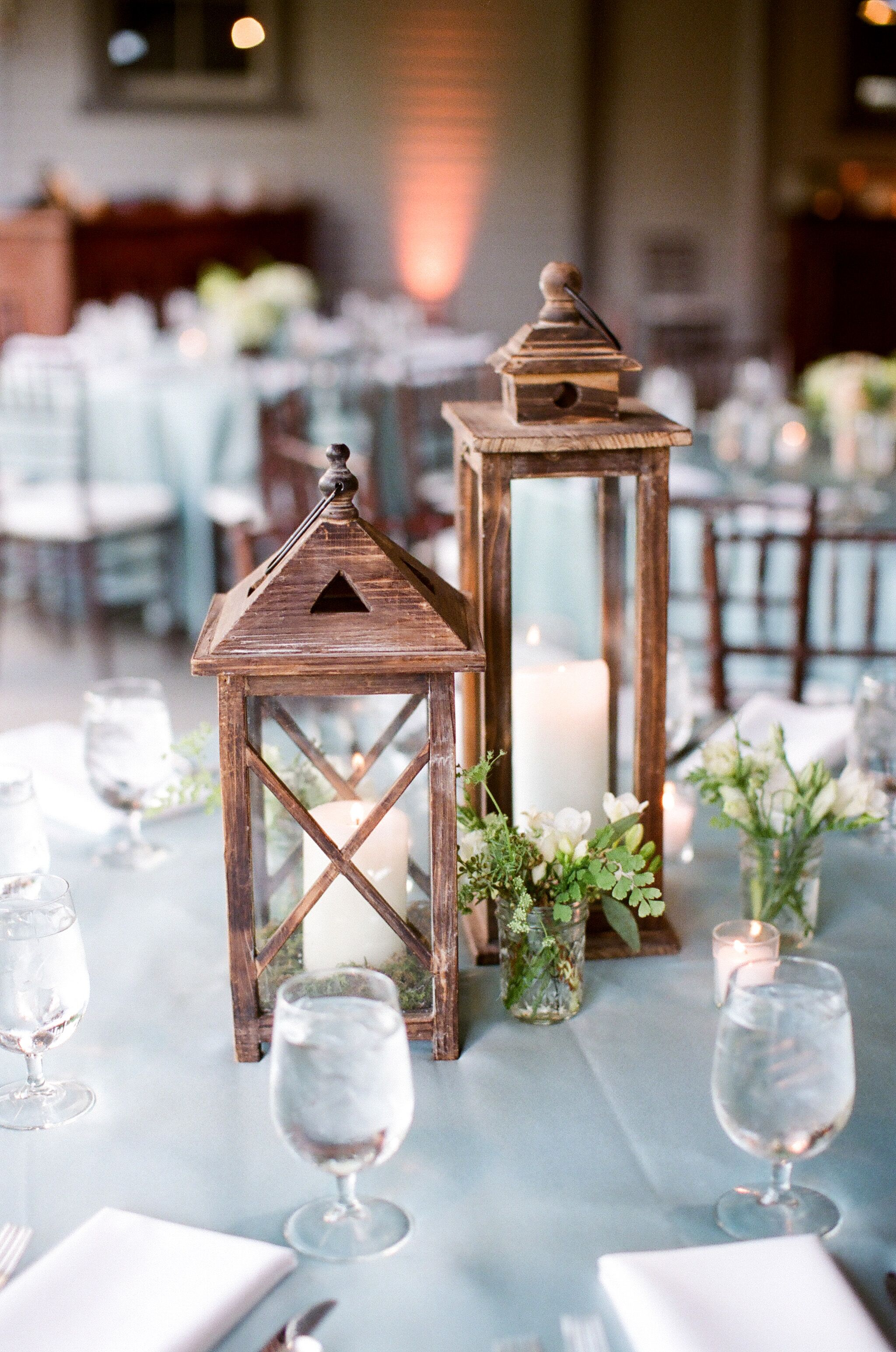 Cornflower blue tables with lantern centerpieces
