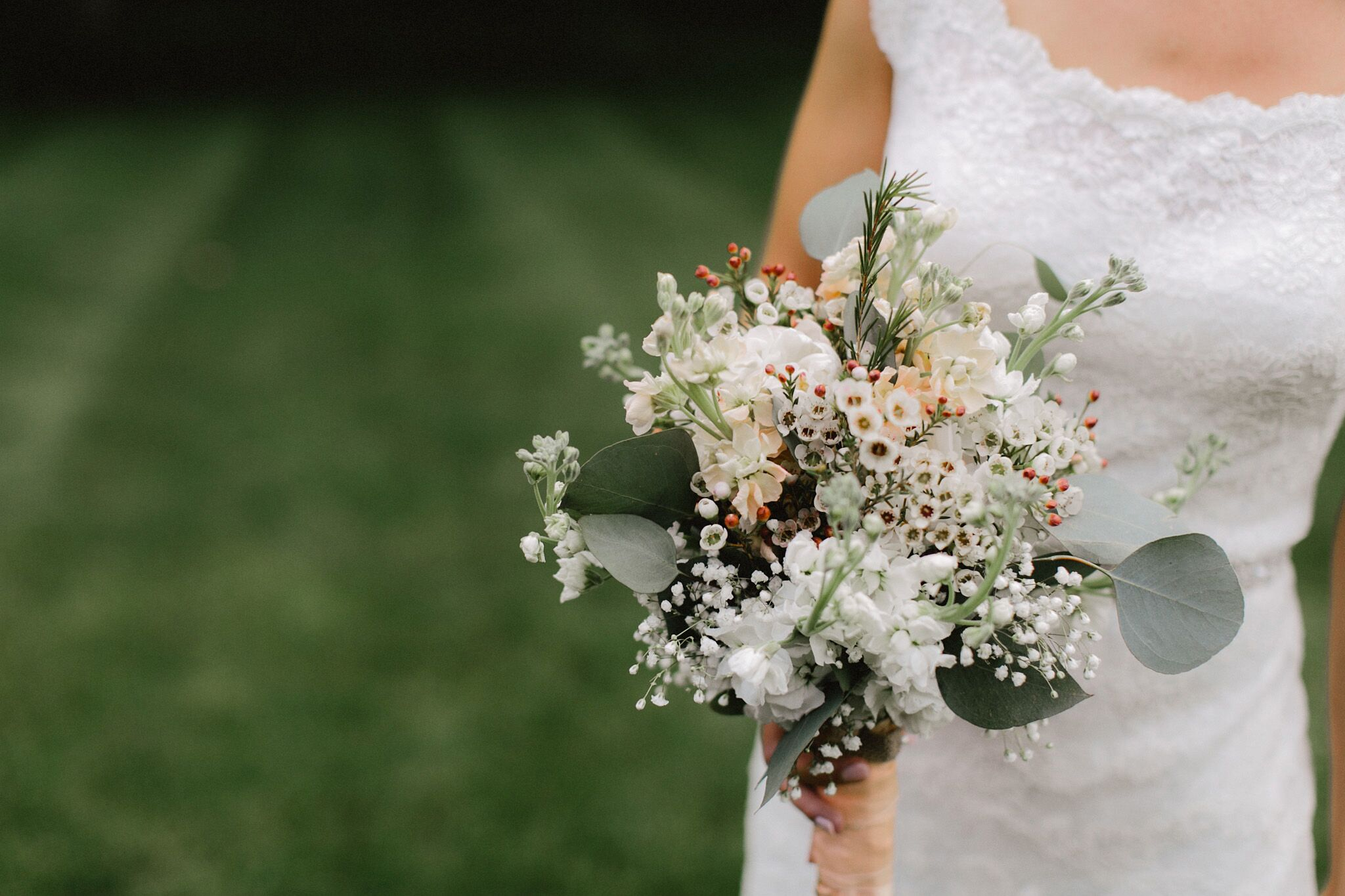A romantic diy wedding at bieker farms in ada michigan sherri carried a whimsical bouquet of waxflower and babys breath izmirmasajfo