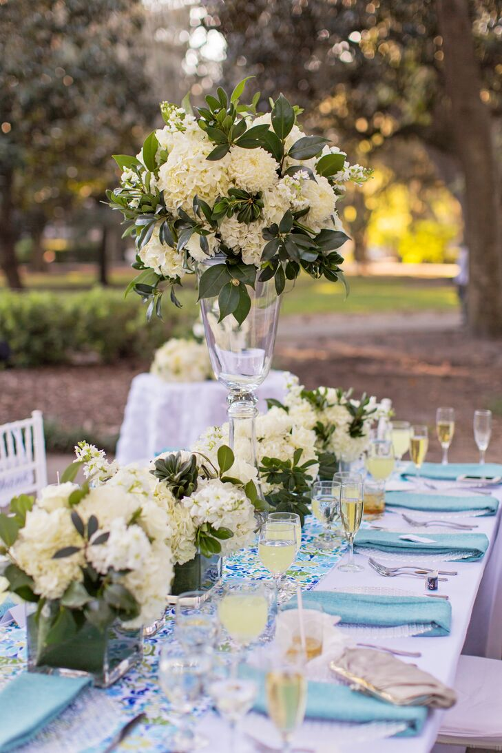 Inspired by her desire for lush white and green florals, Amanda paired her low hydrangea arrangements with a chic aqua patterned table runner.