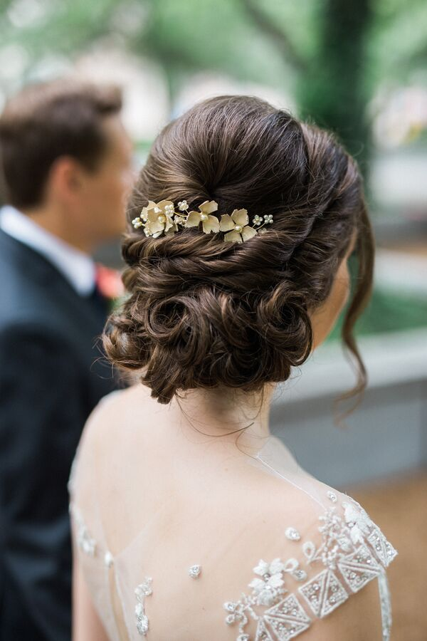 Elegant Curled Updo with Gilded Floral Hairpiece