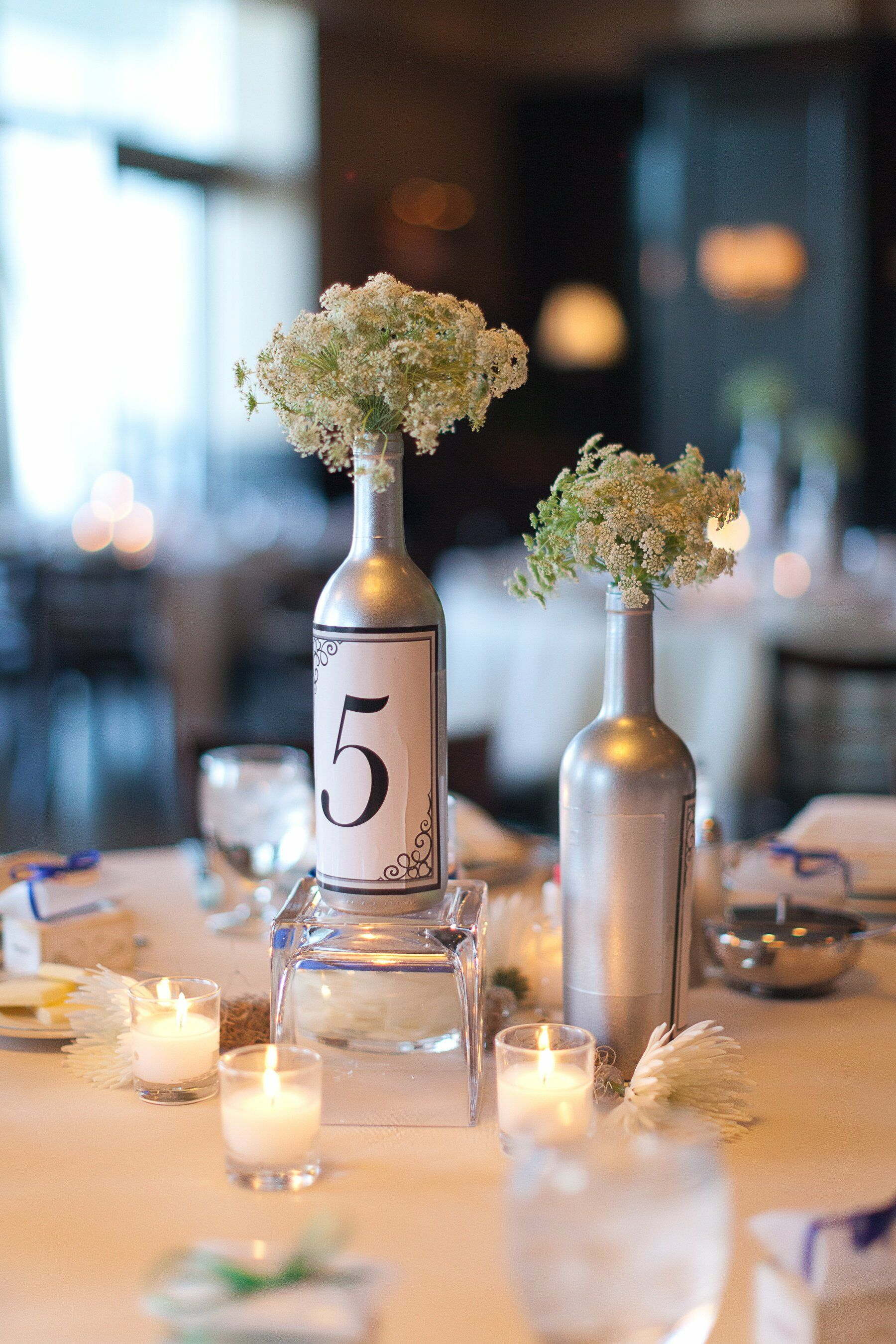 Silver wine bottle centerpieces for Wine bottle ideas for weddings