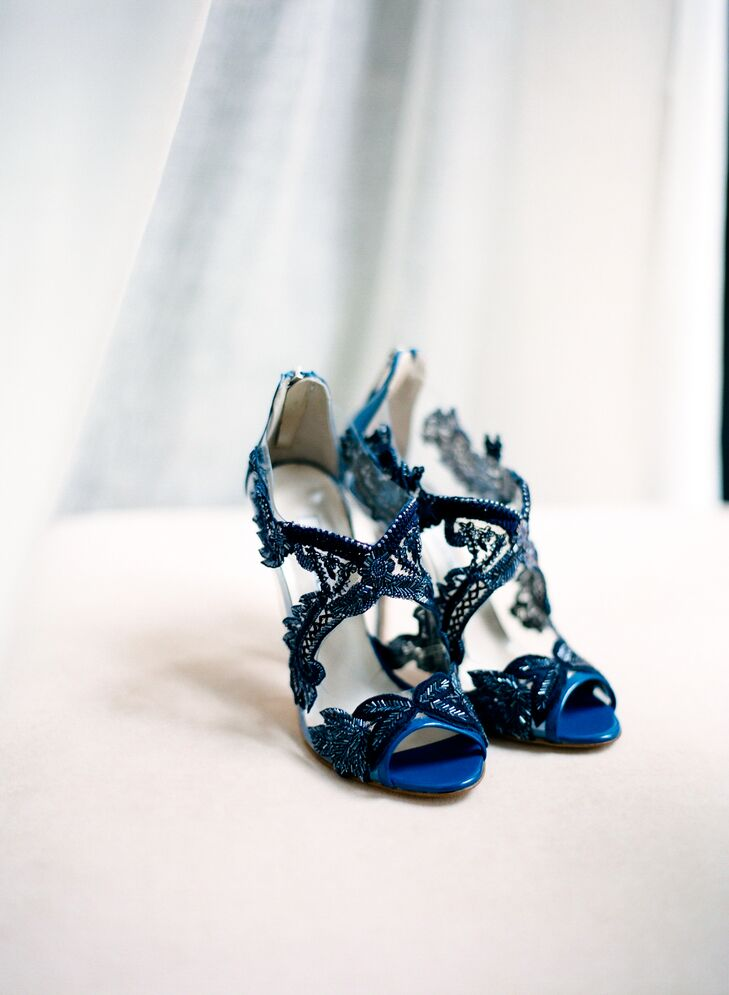 Maggie scored a pair of lace Oscar de la Renta heels to match the blue flowers on her skirt. She wore them for the ceremony, but changed into white Chantilly lace shoes for the reception.
