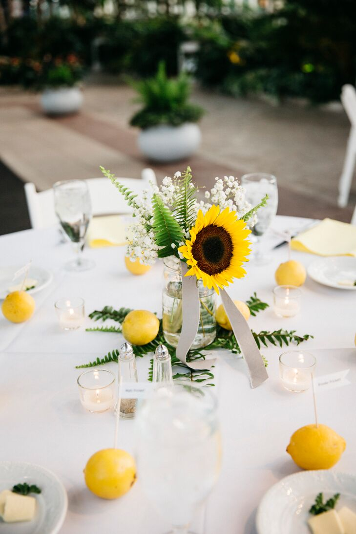 Sunflower fern and lemon wedding centerpieces