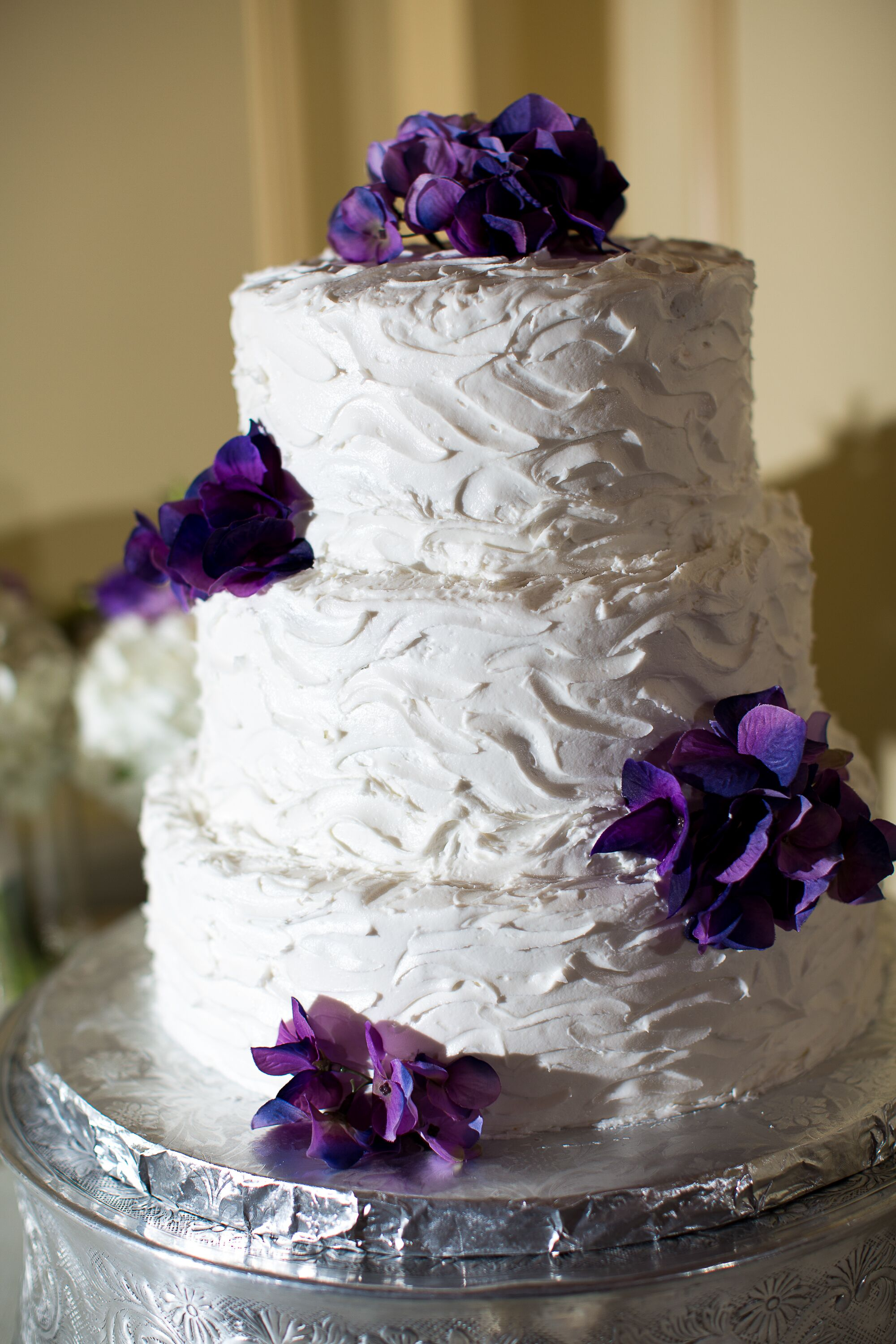 3 tier purple wedding cake three tier buttercream wedding cake with purple flowers 10239