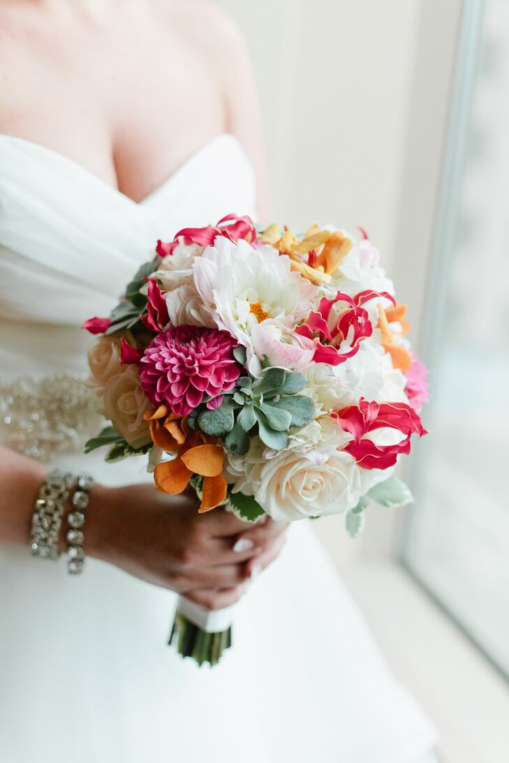 Ali wanted all types of textures and colors in her bouquet, and Florals by Claire totally nailed it. Claire used cream roses, pink dahlias, pink ranunculus, orange gloriosa lilies, green succulents, white hydrangeas and golden lilies in the hand-tied bouquet.