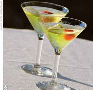 bright green cocktail in a martini glass