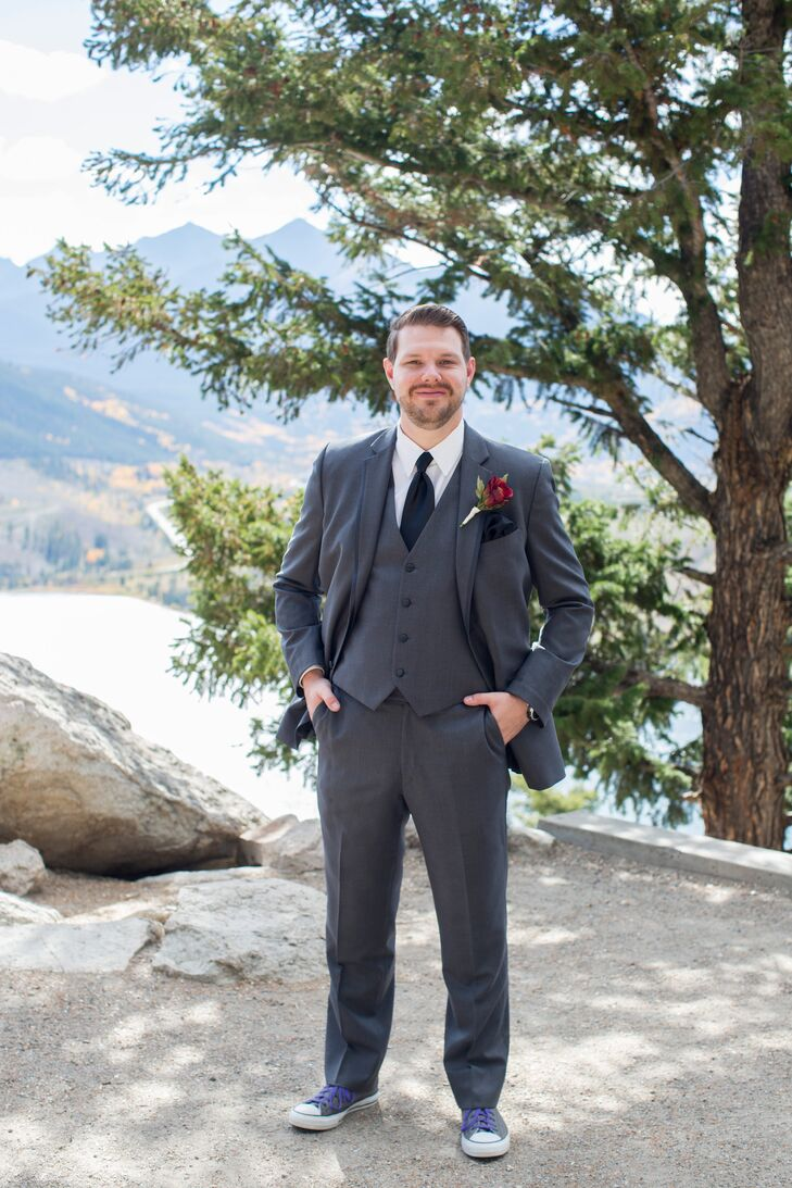 Joe kept his look classic, donning a gray three-piece suit, black tie and pocket square for the wedding. A pair of gray Converse sneakers with purple laces added a fun, personal touch to the look and were practical for the event's mountain top location.