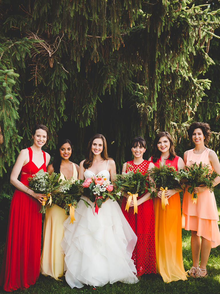 These mismatched bridesmaid dresses are the hottest trend warm fiery hued mismatched bridesmaid dresses ombrellifo Choice Image