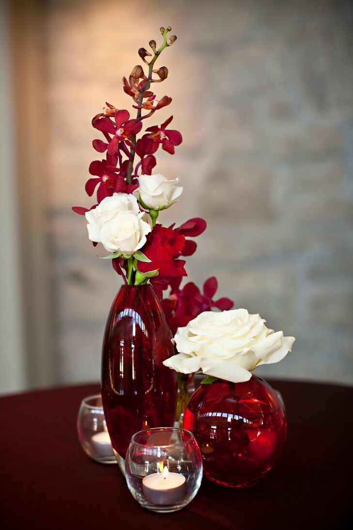 Red and white orchid rose centerpieces
