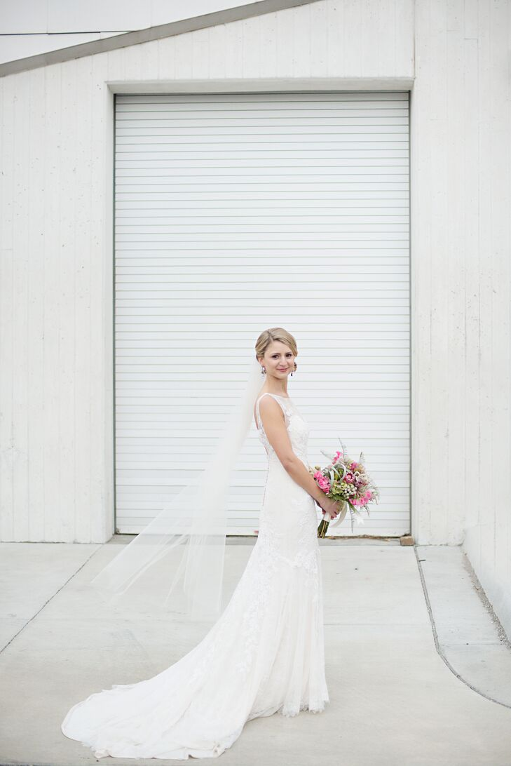 "Anna's gown was an off-white, double-layer lace and sheath dress with an illusion neckline and midlength train. The dress was comfortable, lined with soft silky jersey fabric. ""I was going for a timeless look with a casual twist,"" Anna says."