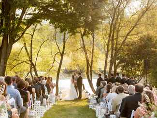 Summer wedding ceremony by lake