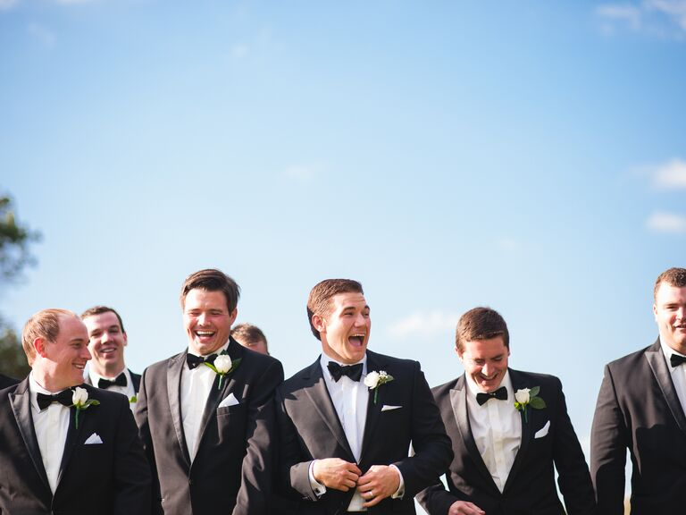 Groom and groomsmen celebrating outside