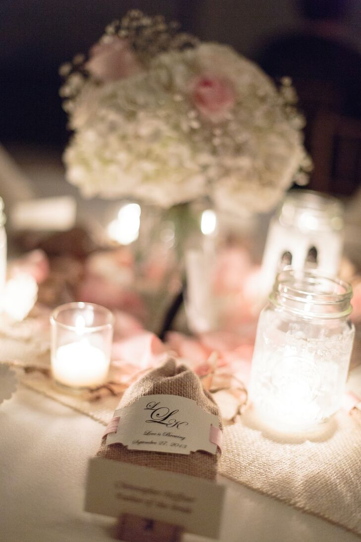 Lindsey and Kris decorated the venue with burlap table runners, lace doilies and candles to create a soft, romantic atmosphere.
