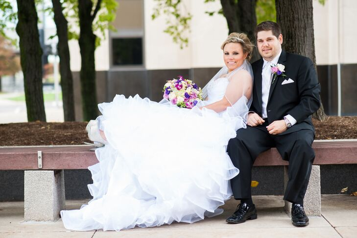 Tiffany's frilly Mori Lee gown looked like a gorgeous, pillowy cloud with both sophisticated elegance and a touch of whimsy. The groom wore a suit from Wesner Tuxedo and a purple and ivory rose boutonniere to match his bride's bouquet.