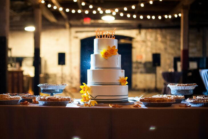 Ann Arbor, Michigan, mainstay Zingerman's created a tiered, round wedding cake for the newlyweds. Aside from a classic wedding cake, the couple also served a variety of homemade pies courtesy of Dangerously Delicious Pies in Detroit.