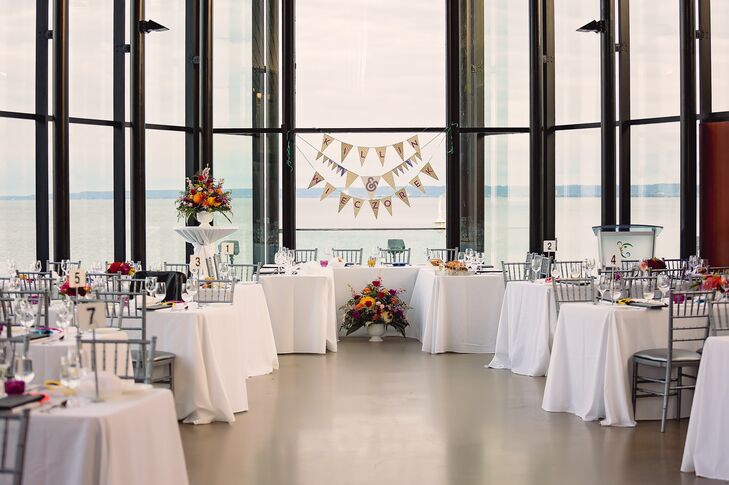 Crisp white linens and silver chairs complemented the modern space at Spencer's at the Waterfront.