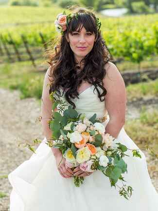 Greenery flower crown with a cluster of garden roses to the side