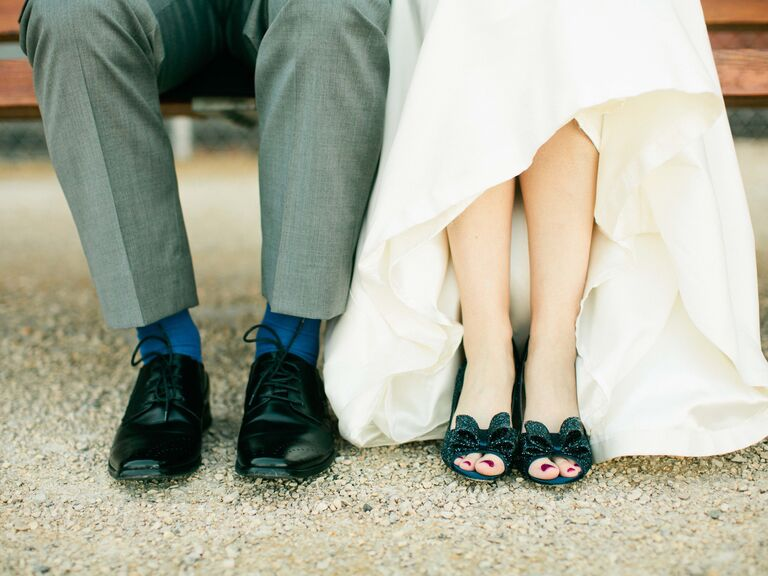 Groom's shoes and bride's blue sparkly heels