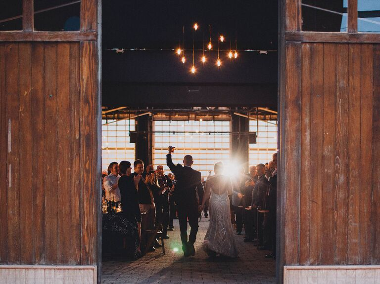 Bride and groom's barn wedding reception entrance