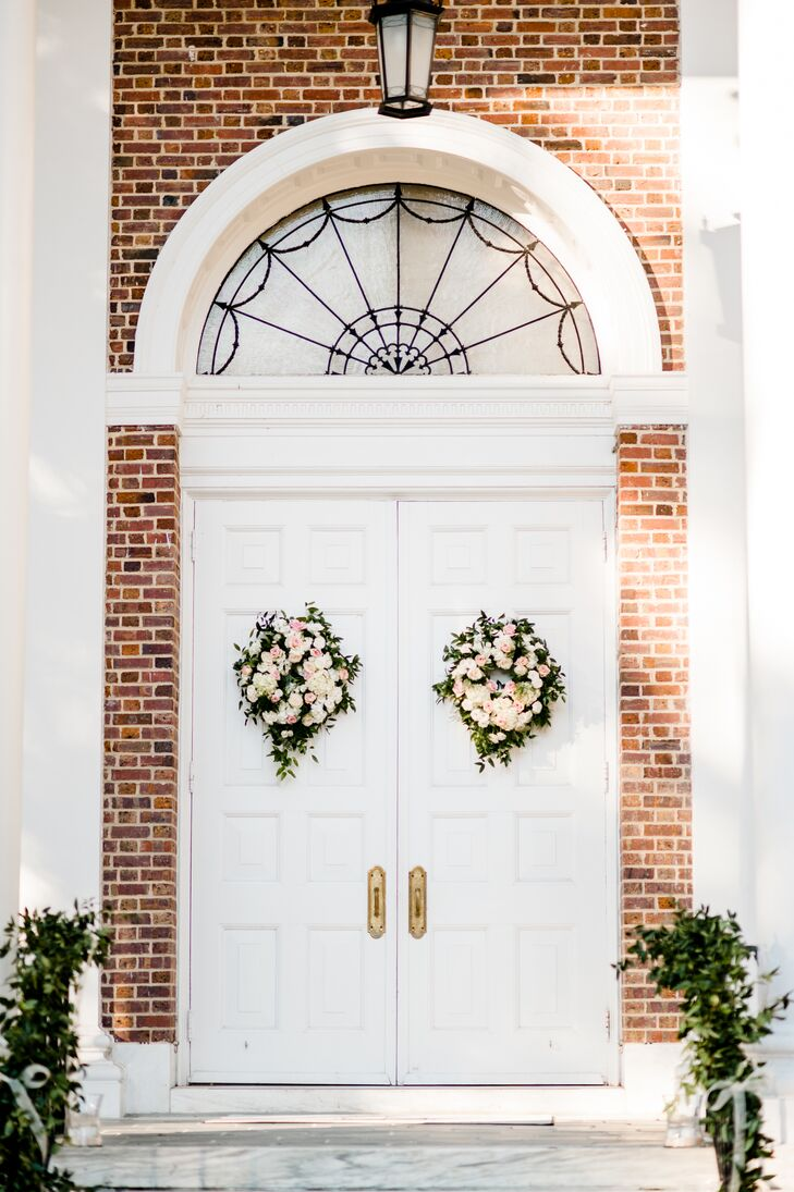 The two large front doors of the church each had a floral wreath.