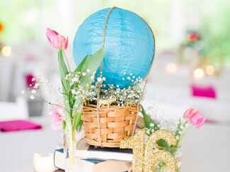 Reception centerpieces made of paper hot air balloons