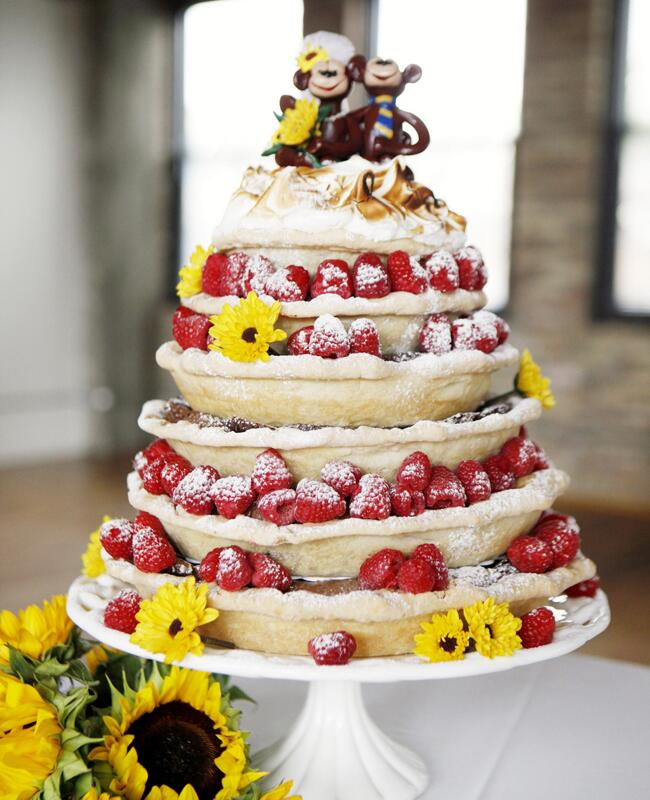 Stacked wedding pies with bride and groom monkey cake toppers.