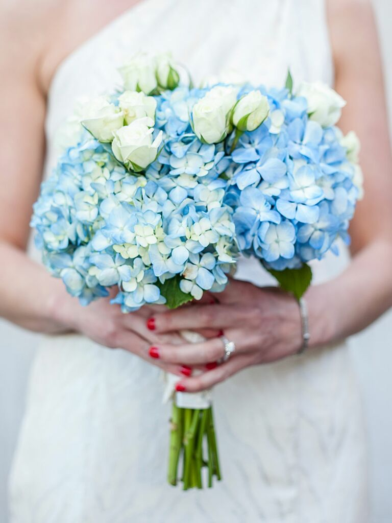 The best blue wedding flowers and 16 gorgeous blue bouquets blue and white wedding bouquet with roses and hydrangea junglespirit Images