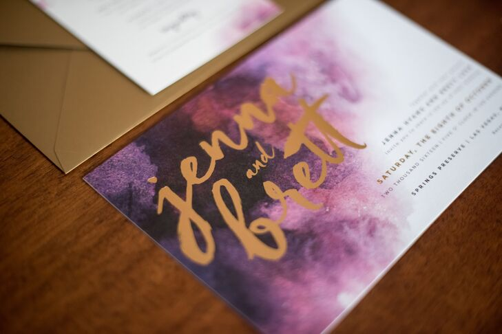 The day's rich palette of plum and gold was reflected in the invitation suite, which had a soft watercolor theme.