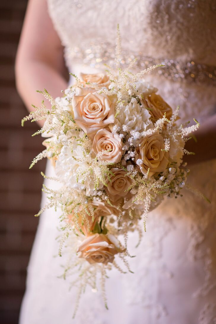 Leah carried a beautiful textured bouquet of cascading ivory roses that looked almost antique, befitting her vintage wedding theme. When she could not wear her grandmother's wedding dress, she took a swatch of the gown to tie around her flowers.