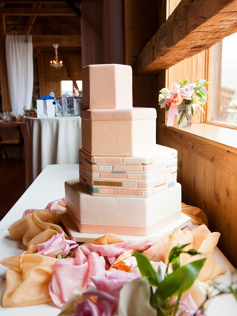 Staircase wedding cake with geometric shaped tiers