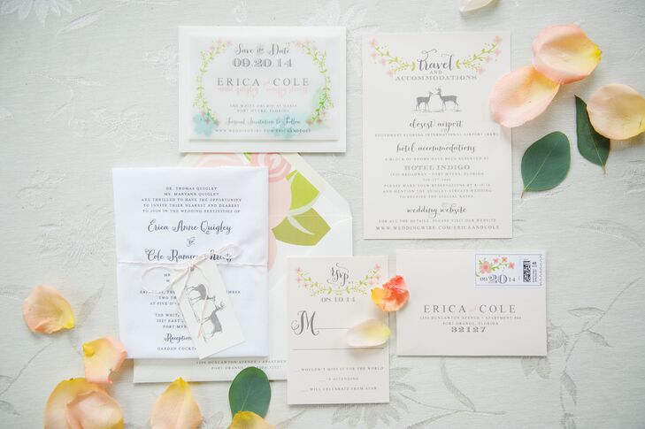 "The couple chose woodland accented stationery and invitations from DM Paper Designs. Each piece had a pink floral or deer accent. ""The actual wedding invitations were printed on a lace handkerchief with matte white cards for additional information, such as accommodations and RSVP cards.  The handkerchief was wrapped around the matte cards and tied with twine,"" says Erica."