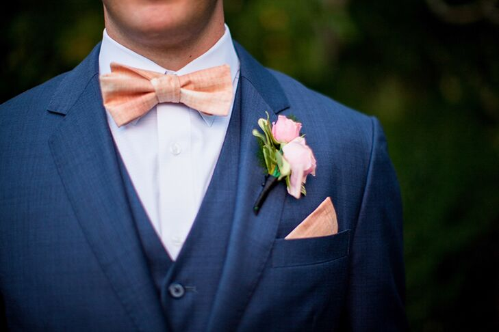 Adam's blush bow tie, pocket square and boutonniere inspired many details throughout the wedding.