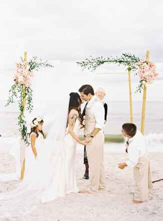 Ceremony kiss under a decorated huppah