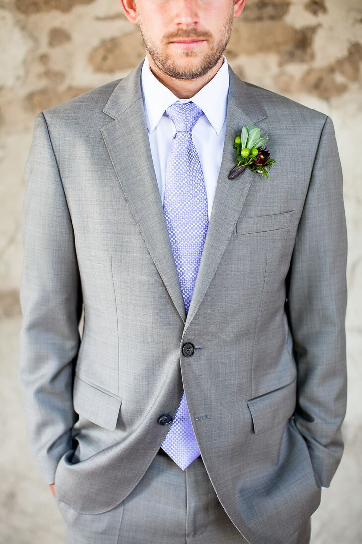 Groom is Dressed in a Light Gray Suit with a Light Blue Tie