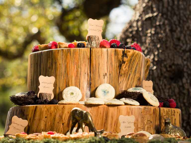 Natural wooden dessert display with vintage gold figurines
