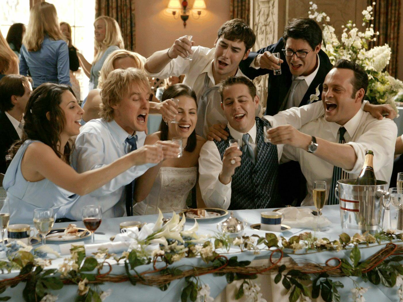 Who attends the wedding rehearsal dinner?