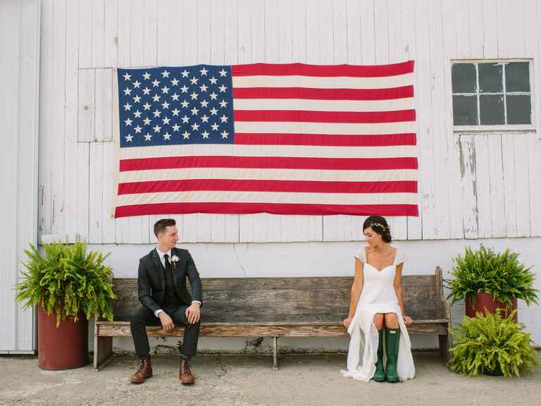 Bride and groom portrait underneath and American flag