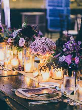 Purple rose centerpieces and whimsical candle light wedding decorations