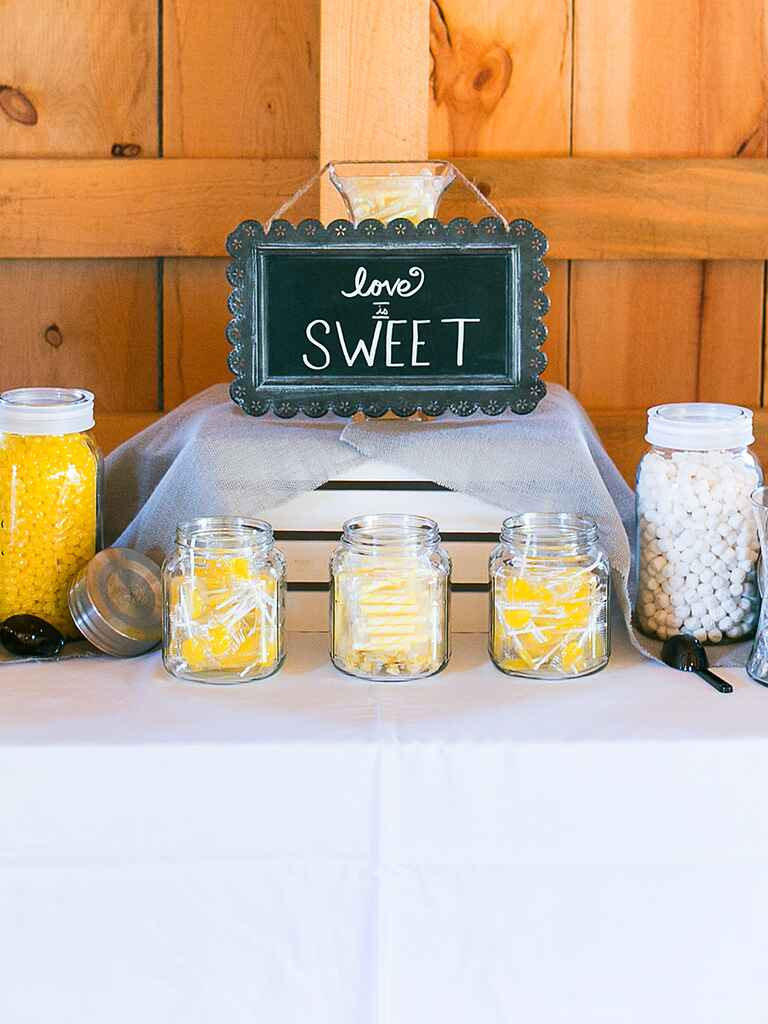 Yellow and white wedding reception candy bar