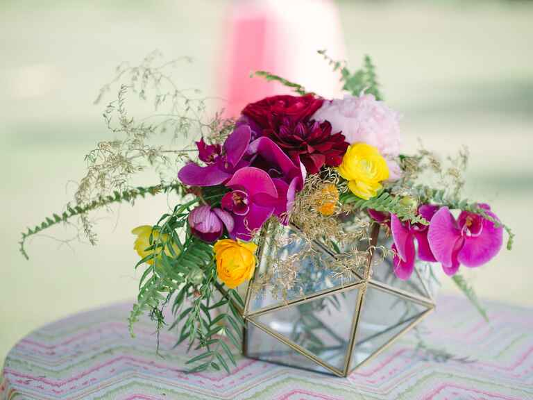 Glass decoration draped with orchids, roses, peonies and chrysanthemums