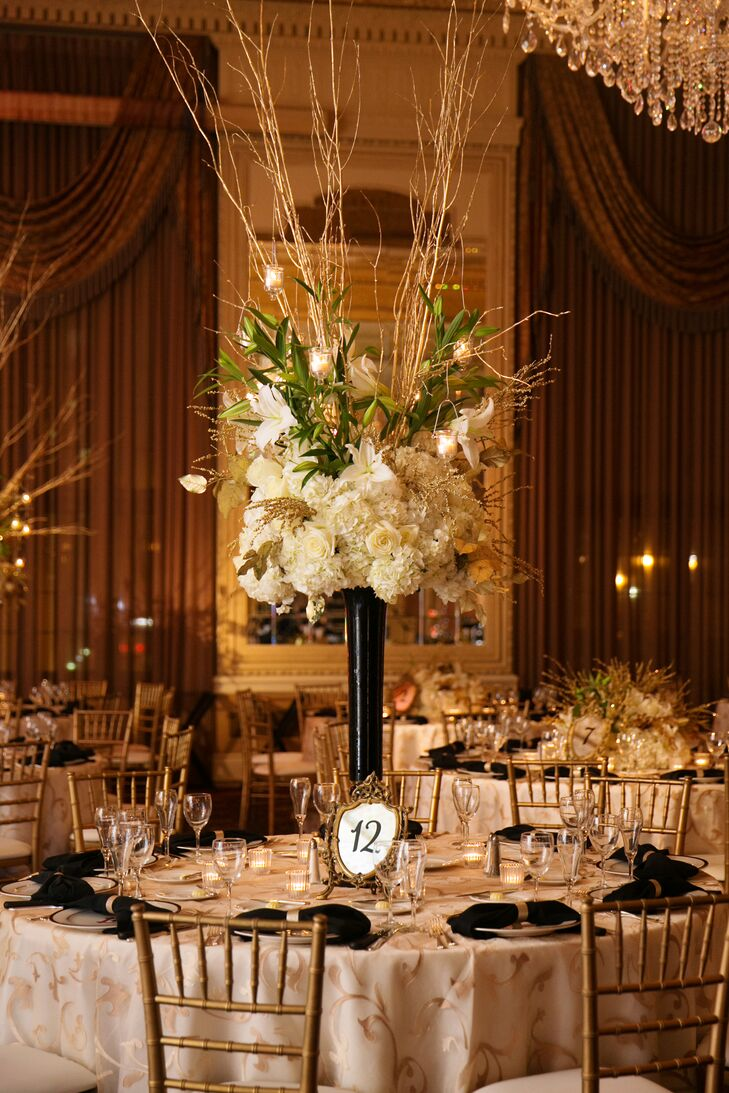Tall black centerpiece arrangement with gold branches