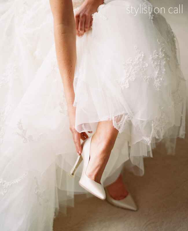 changing your shoes from ceremony to reception | Sara Hasstedt Photography |blog.theknot.com