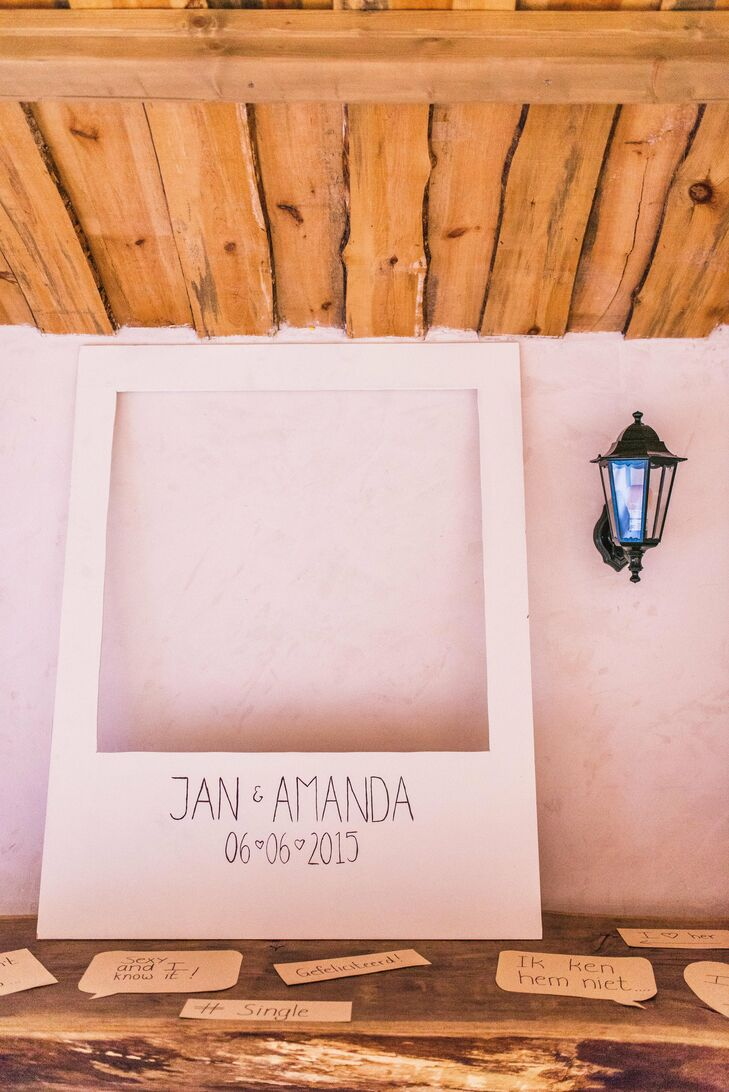 At the reception, Amanda and Jan set up a oversize frame that resembled a Polaroid picture for the photo booth. They also provided their guests with speech-bubble props.