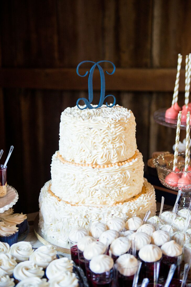 """In addition to the cake, we had a dessert bar with other flavors of wedding cake, cupcakes, cake pops, pies and marinated berries and meringues. We hope not a guest went home hungry!"""